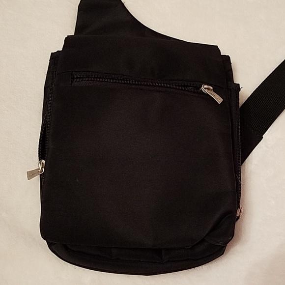 Travelon crossbody bag. M 5b4e15386197459d91bb8f6d a27d339027